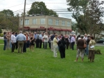 Members of the Class of 1961 and family members of the classmates we have lost gather on the former DHS campus.
